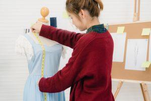 Professional beautiful Asian female fashion designer working mea