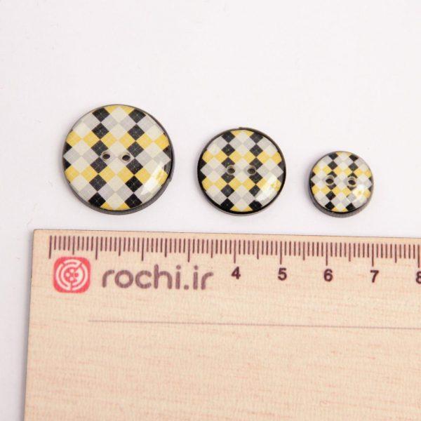 دکمه چهارخانه زرد و سیاه